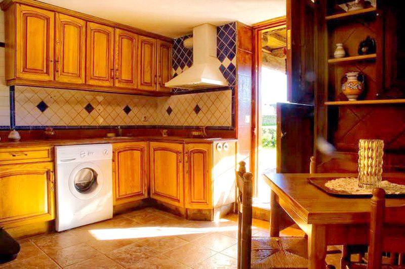 Posada Puente Romano cocina de uno de los apartamentos