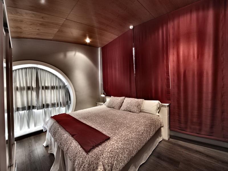 Habitación con cama de matrimonio de Apartamentos El Caserio Suances